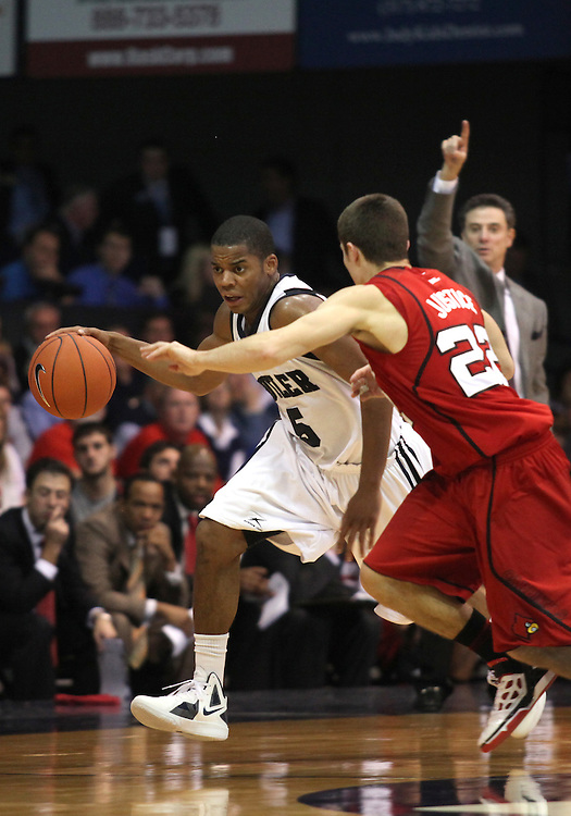 November 19, 2011: Butler's Ronald Nored brings the ball up the court against Louisville during the game at Hinkle Fieldhouse in Indianapolis, Ind. Louisville won 69-53.