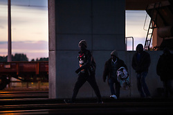 **Images taken on the evening of the 10th of August** © Licensed to London News Pictures. 10/08/2015. Calais, France. Migrants make their way along the train tracks to the Eurotunnel terminal at Frethun near Calais, northern France. Migrants continue to gain easy access to the Eurotunnel site despite increased security and police numbers.. Photo credit: Ben Cawthra/LNP