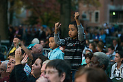 Children cheer for President Obama at a rally on the College Green in Athens. Photo by Ben Siegel/ Ohio University