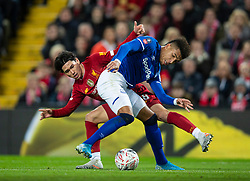 LIVERPOOL, ENGLAND - Sunday, January 5, 2020: Liverpool's new signing Japan international Takumi Minamino (L) and Everton's Mason Holgate during the FA Cup 3rd Round match between Liverpool FC and Everton FC, the 235th Merseyside Derby, at Anfield. (Pic by David Rawcliffe/Propaganda)
