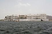 India, Rajasthan, Udaipur A boat ride in lake Pichola, The Taj Lake palace hotel.