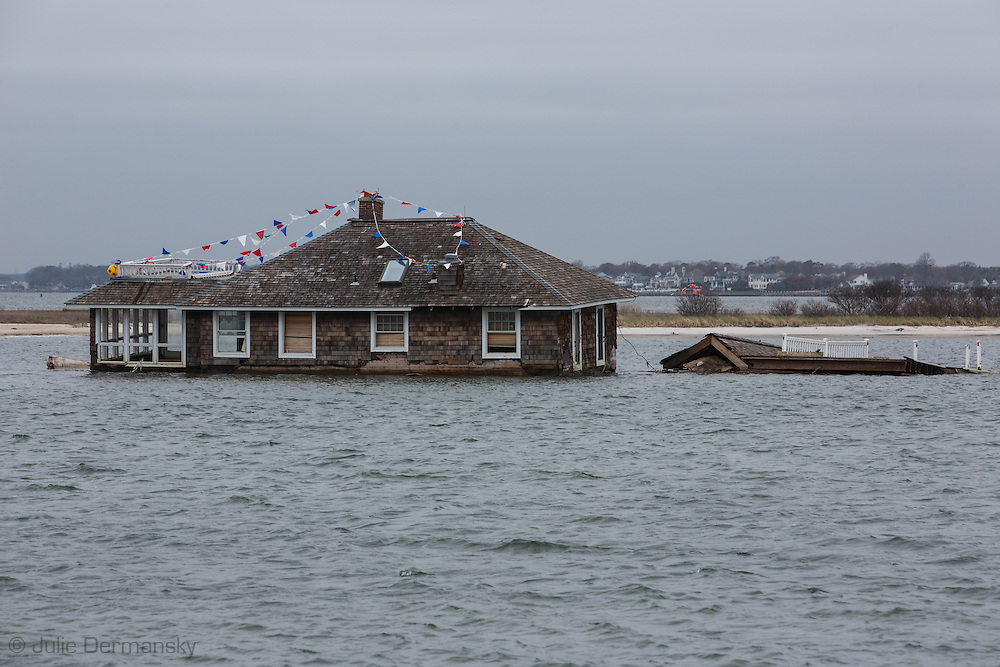 April 23, 2013, Mantoloking New Jersey, A house in the Bay moved by Superstorm Sandy's surge sixth months after the storm. The process of removing totaled homes started recently and will pick up in early May as more permits for demolition are issued.