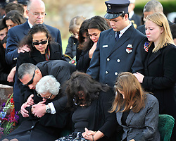 "Family members of Samir Ashmar react at a grave side service. Funeral services with for Upper Macungie Township Fire Marshal Samir ""Sam"" Ashmar, 51 were held on November 25th, 2014, in Allentown, Pa. Ashmar died on November 20th in the line of duty following an emergency call. (Chris Post 