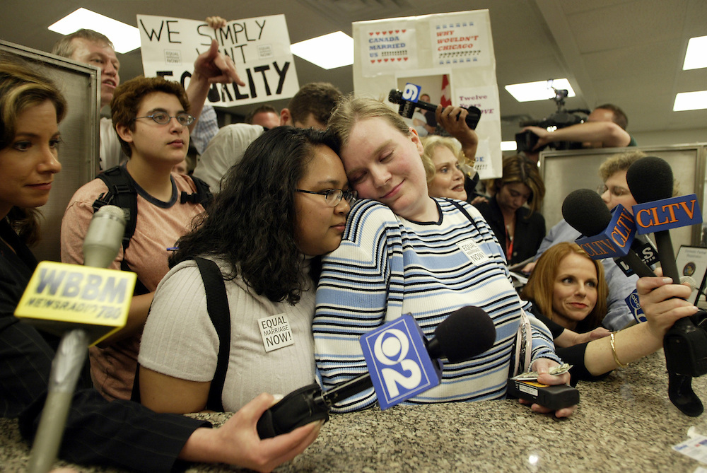Michelle Baladad, left, and Jennifer Widd attempt to get a marriage license while surrounded by gay marriage rights demonstrators and media at the office of Cook County Clerk David Orr in Chicago Monday afternoon.  They were denied since gay marriage is against state law in Illinois.