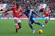 Birmingham City midfielder Jacques Maghoma attempts to turn Bristol City defender Mark Little during the Sky Bet Championship match between Bristol City and Birmingham City at Ashton Gate, Bristol, England on 30 January 2016. Photo by Alan Franklin.