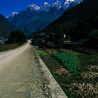 Country road leads to Jade Dragon Mountain, Lijiang, China