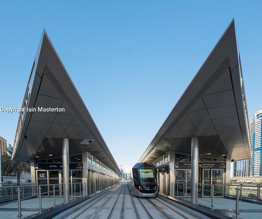 Station and tram on new Dubai Tram system in Marina district of Dubai United Arab Emirates