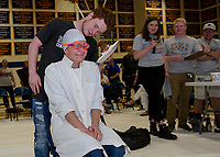 """Lorienne Valovanie dressed for the occasion but still shows apprehension as Ryan Hamel gets ready to """"Pie his Teacher"""" at Gilford High School's fundraiser to benefit The Doorway at LRGH on Friday afternoon.  (Karen Bobotas/for the Laconia Daily Sun)"""