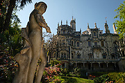 Statue and main palace at Quinta da Regaleira, an estate, near Sintra, Portugal, and a UNESCO World Heritage Site.