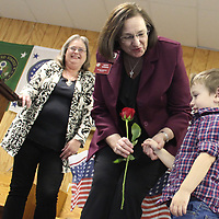 American Legion Auxiliary National President Kathy Dungan accepts a rose from Cason Nash during her visit to Aberdeen. Also pictured is unit president Diane Belue.