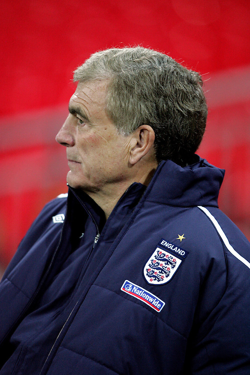 Sir Trevor Brooking looks on as Fabio Capello takes charge of his first England training session in front of the media at Wembley Stadium, 4th Feb 2007.