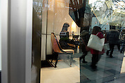 upscale shop with host and shoppers reflected in window Tokyo Japan