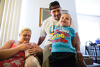 Jason Hill spends time with his son Jordan Hill, 4, and his fiancè Iris Leland before going to work Friday, July 24, 2015 in Spokane, Wash.