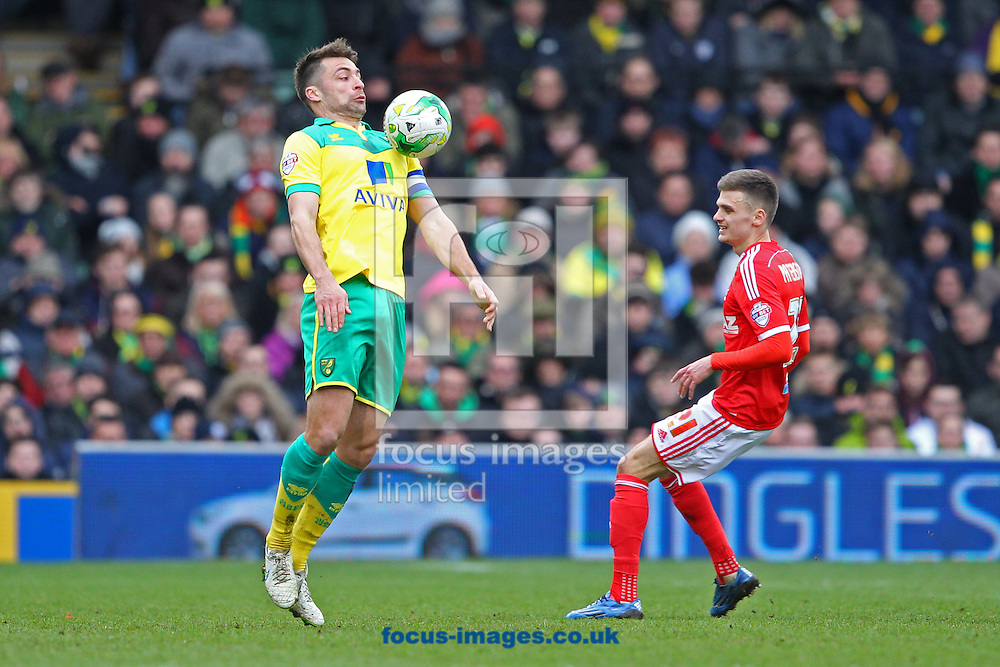 Russell Martin of Norwich and Jamie Paterson of Nottingham Forest in action during the Sky Bet Championship match at Carrow Road, Norwich<br /> Picture by Paul Chesterton/Focus Images Ltd +44 7904 640267<br /> 21/03/2015