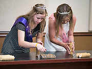 27 JUNE 2019 - CENTRAL CITY, IOWA: The Linn County Fair royalty shows how to stack sandwich cream cookies during the cookie stacking contest at the Linn County Fair. Summer is county fair season in Iowa. Most of Iowa's 99 counties host their county fairs before the Iowa State Fair, August 8-18 this year. The Linn County Fair runs June 26 - 30. The first county fair in Linn County was in 1855. The fair provides opportunities for 4-H members, FFA members and the youth of Linn County to showcase their accomplishments and talents and provide activities, entertainment and learning opportunities to the diverse citizens of Linn County and guests.        PHOTO BY JACK KURTZ