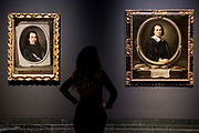 UNITED KINGDOM, London: 27 February 2018 A visitor takes a close look at Bartolomé Esteban Murillo's 'Self Portrait' (about 1650-55, left) and 'Self Portrait' (about 1670, right) at the new exhibition entitled 'Murillo: The Self Portraits' at The National Gallery in London this morning. <br /> The exhibition marks the 400th anniversary of one of the most celebrated Spanish artists. <br /> Rick Findler  / Story Picture Agency