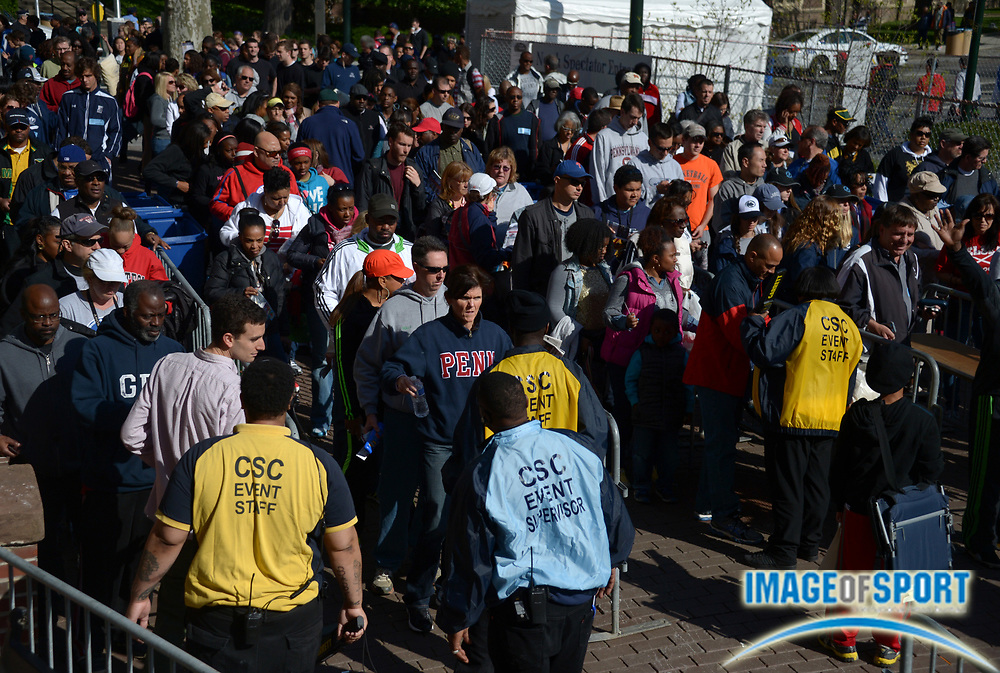 Apr 26, 2013; Philadelphia, PA, USA; Spectators pass through a security check at the entrance to the 119th Penn Relays at Franklin Field.