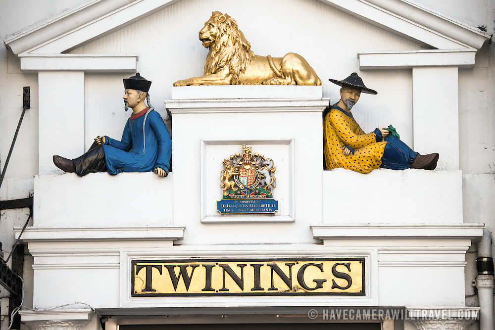 Decorations above the door to the traditional London headquarters of Twinings of London, tea importers, on the Strand in central London. Figures represent historic Chinese origins of Twinings' tea imports.