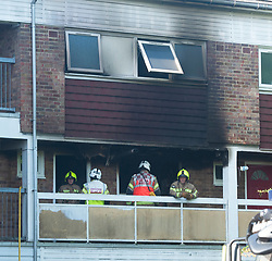 © Licensed to London News Pictures. 20/08/2019.<br /> Orpinton ,UK. Fire investigation officers. London Fire Brigade, Police and the London Ambulance Service are all in attendence this morning at a serious flat fire in Petten Grove, Orpington, South East London which has seen three people taken to hospital suffering from smoke inhalation one of the three is a child. A police cordon is in place as fire investigation officers work on scene. Photo credit: Grant Falvey/LNP
