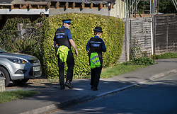 © Licensed to London News Pictures. 03/10/2016. Crowthorne, UK. Police Community Support Officers patrol near a house where police found a women in her 50's, who was dead, and an injured man. It is thought that the incident is being treated by the Thames Valley Police as one case of murder and one of attempted suicide.  Photo credit: Peter Macdiarmid/LNP