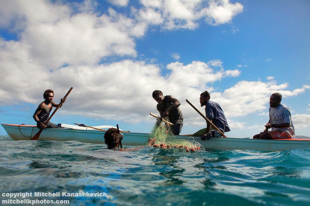 Ni Vanuatu men  fishing with a net on Uleveo/Maskelyne Island, Malampa Province, Malekula, Vanuatu