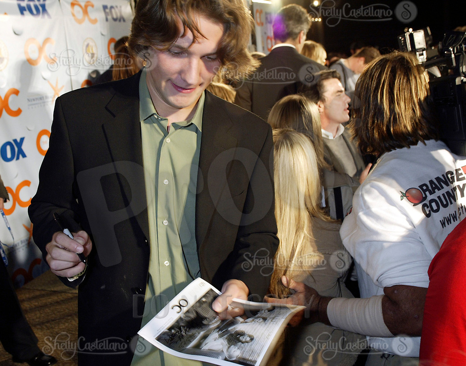 Oct 28, 2004; Newport Beach, CA, USA; Cast Member MICHAEL CASSIDY who plays Zach on the FOX hit TV show 'The OC' visited the Balboa Penninsula in Newport Beach to get a Key to the City and be immortalized in cement with thier hand prints to be placed at the enterance to the Historic Balboa Pavillion. Cassidy signs autographs.  Mandatory Credit: Photo by Shelly Castellano/ZUMA Press.