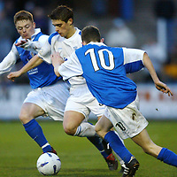 Queen of the South v St Johnstone..1.11.03<br />Ross Forsyth tries to make his way through David Bagan and Paul Burns<br /><br />Picture by Graeme Hart.<br />Copyright Perthshire Picture Agency<br />Tel: 01738 623350  Mobile: 07990 594431