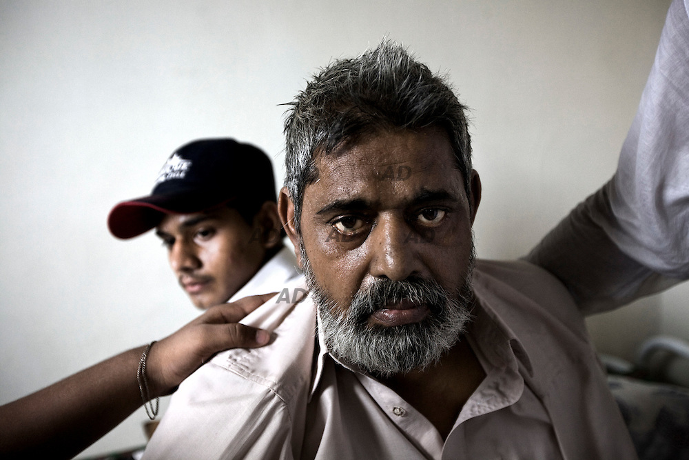 "The family of the activist of the Muttahida Qaumi Movement (MQM) 28-year-old Atiq-ur-Rehman. He was shot dead while two others were injured by unidentified assailants. No one says openly, but everyone thinks and indicate the MQM-H, the rival faction of the MQM. The father was shocked and he never leaves the house lying in bed: "" He was a good boy, he had not hurt anyone."", he said. Behind him, the son and brother of the dead. *** General Caption *** Muttahida Quami Movement, generally known as MQM , (""United National Movement"" in English) is an progressive liberal secular centre left party in Pakistan (initially on quasi-socialist lines) founded on 11 June 1978 as a student organization of ""muhajir"" (immigrants), the  All Pakistan Muhajir Students Organization or APMSO, at the University of Karachi by Altaf Hussain who continues to remain its chief. Supposedly it represent the majority of immigrants who migrated from India to Pakistan in 1947. APMSO then gave birth to the Muhajir Quami Movement (MQM) on March 1984. From 1992 to 1994, the MQM was the target of the Pakistan Army's Operation Cleanup leaving hundreds of civilians dead. On July 26, 1997, MQM officially removed the term Muhajir from its name, and replaced it with Muttahida (""United""). In 1992, after the operation ""Clean up"", there was the split with key members of the party: the MQM-H or MQM Haqiqi, the ""real"" MQM, was born. Since then have not stopped the target killing from both sides. The target killing is getting intensified in Karachi with the military's ongoing counterinsurgency operation in Swat and Malakand. The MQM party is, maybe, the worst enemy of the taliban in Pakistan."