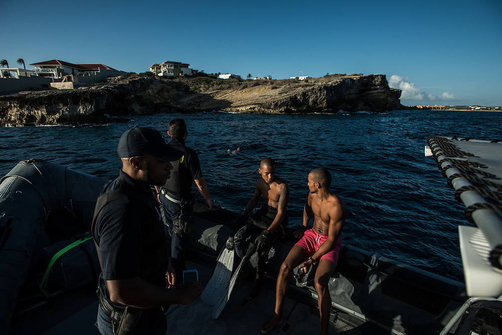 """WILLEMSTAD, CURAÇAO - OCTOBER 24, 2016: Members of the Dutch Caribbean Coast Guard patrol Caracas Bay, where Roymar Bello was thrown into the sea by smugglers. The Coast Guard patrols looking for suspicious vessels that might be carrying migrants or illegal contraband. Authorities in Curaçao fear the Venezuelan migrants will undercut the labor force or bring violent crime. """"My preoccupation is what kind of people are entering Curaçao,"""" said Nelson Navarro, the island's justice minister who argued that the increase in Venezuelans coincided with a 15 percent rise in crime, particularly armed robberies. """"In Venezuela, they don't hesitate to shoot a police officer, but here, this is news."""" Alex Rosaria, a legislator on the island, worries the migrants will further strain Curaçao, where unemployment is at 11%. """"We have only a limited capacity to deal with refugees,"""" Mr. Rosaria said. For now, the task has been left to the Caribbean Dutch Coast Guard, which is funded by the Netherlands, the former colonial power here. Rob Jurriansen, a Dutch naval officer who heads operations in Curaçao, says his small fleet intercepts only a tiny fraction of the migrants, perhaps just 5% of the boats coming from Venezuela. Now he says officials in Netherlands fear they will also get stuck with the bill of caring for a migrant tide. """"They want to prevent a situation like Libya,"""" he said, referring to the much larger flow of migrants crossing the Mediterranean to reach Europe. PHOTO: Meridith Kohut for The New York Times"""