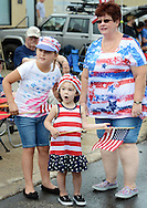 From left, Angie Vangas, 10, Ava Vangas, 3 and their grandmother Marianne McQuaid of Northeast Philadelphia reacts as a group of horses march in the Lower Southampton Independence Day Parade Saturday July 4, 2015 in Feasterville, Pennsylvania. (Photo by William Thomas Cain)