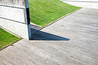 Shadow on the concrete floor from wall