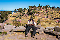 Puno, Peru - July 25, 2013: old man weaving in the peruvian Andes at Taquile Island on Puno Peru at july 25th, 2013.