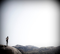 A rock climber pauses for a moment at Joshua Tree National Park in Southern California.
