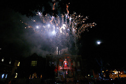 © Licensed to London News Pictures.  28/08/2012. AYLESBURY, UK. Paralympic themed images are projected onto the Aylesbury Crown Court building and fireworks let off during a Paralympic flame celebration in Aylesbury town centre. Nearby Stoke Mandeville is the birthplace of the Paralympics and a 24 hour torch relay began at 8pm this evening (Tuesday) and will finish in the Olympic Park in Stratford tomorrow. Photo credit :  Cliff Hide/LNP