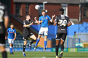 Andy Cannon wins a header during the EFL Sky Bet League 1 match between Rochdale and Bury at Spotland, Rochdale, England on 26 August 2017. Photo by Daniel Youngs.