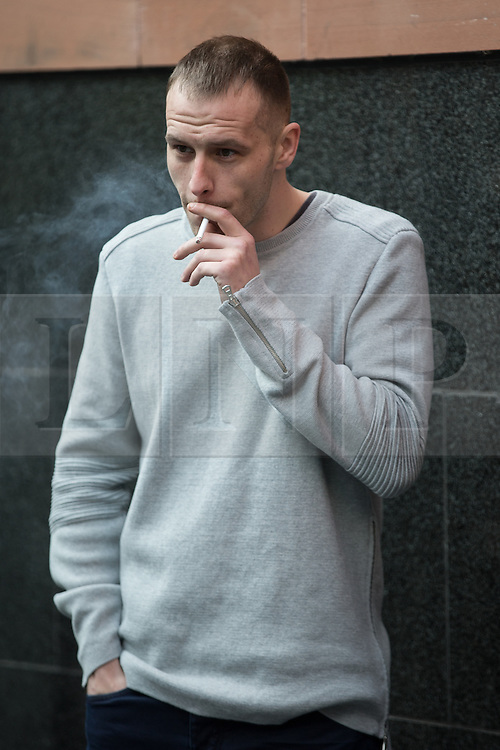 """© Licensed to London News Pictures . 18/03/2015 . Manchester , UK . LIAM GARY EDWARDS (29) outside Manchester and Salford Magistrates Court this morning (18th March 2015). Edwards is charged with Causing Racially or Religiously Aggravated Criminal Damage . On 18th February 2015 , stickers reading """" Beware! Halal is barbaric and funds terrorism """" were discovered on products and displays in Sainsbury's supermarket , on Regent Road in Salford . Photo credit : Joel Goodman/LNP"""