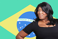 Portrait of casual mixed race woman over Brazilian flag