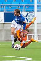 Treningskamp fotball 2014: Molde - Aalesund. Moldes Daniel Berg Hestad (t.v.) i duell med Fredrik Ulvestad i treningskampen mellom Molde og Aalesund på Aker stadion.