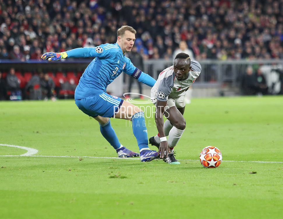 Said Mane of Liverpool against Manuel Neuer of Bayern Munich during the Champions League round of 16, leg 2 of 2 match between Bayern Munich and Liverpool at the Allianz Arena stadium, Munich, Germany on 13 March 2019.