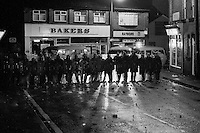 Police behind riot shields at night in South Elmsall, 1984 Miners Strike...© Martin Jenkinson, tel 0114 258 6808 mobile 07831 189363 email martin@pressphotos.co.uk. Copyright Designs & Patents Act 1988, moral rights asserted credit required. No part of this photo to be stored, reproduced, manipulated or transmitted to third parties by any means without prior written permission.