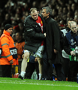 Jose Mourinho, Manager of Inter Milan and Wayne Rooney of Manchester United embrace after the UEFA Champions League First Knockout Round Second Leg match between Manchester United and Inter Milan at Old Trafford on March 11 2009, in Manchester, England.
