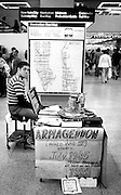Armageddon sign and literature table in large, open subway area in New York. Smaller sign predicts World War III in July 1985, and the return of the Messiah in 1988. every New Yorker and commuter in New York has seen similar end-of-the-world fanatics,