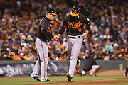 Baltimore Orioles first baseman Chris Davis (19) celebrates with Baltimore Orioles third base coach Bobby Dickerson (11) after hitting a home run against the San Francisco Giants at AT&T Park in San Francisco, Calif., on August 12, 2016. (Stan Olszewski/Special to S.F. Examiner)