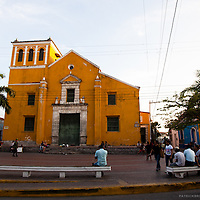A yellow church in the Old Town of Cartagena is a popular hangout for locals and travelers.