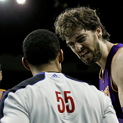 April 9, 2012; New Orleans, LA, USA;  Los Angeles Lakers center Andrew Bynum (17) and power forward Pau Gasol (16) argue an out of bounds call with referee Bill Kennedy (55) during the fourth quarter of a game against the New Orleans Hornets at the New Orleans Arena. The Lakers defeated the Hornets 93-91. Mandatory Credit: Derick E. Hingle-US PRESSWIRE