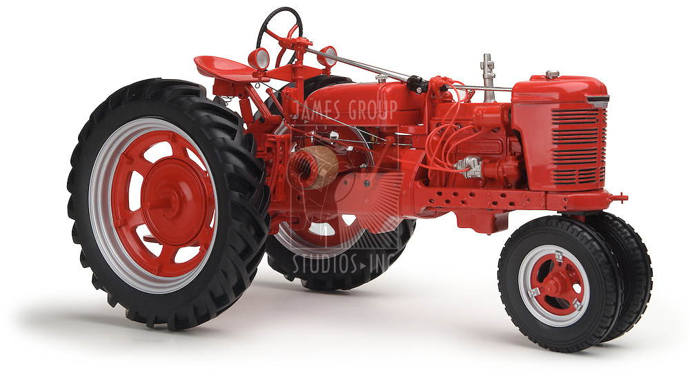 red Farmall tractor on white background shot at eye level