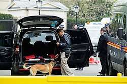 © London News Pictures. 22/04/2016. London, UK. A car being searched by an american sniffer dog team. Heightened security surrounding the residence of the US Ambassador to the United Kingdom in Regents Park, London, where the President of the United States Barak Obama is staying during his visit to the UK. Photo credit: Ben Cawthra/LNP
