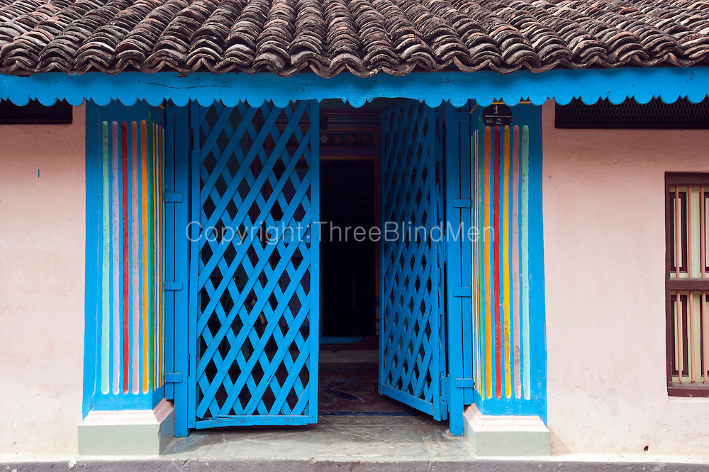 Detail of entrance and painted wall. Home in Nagapattinam.