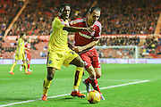 Burnley defender Tendayi Darikwa  and Middlesbrough forward Kike  during the Sky Bet Championship match between Middlesbrough and Burnley at the Riverside Stadium, Middlesbrough, England on 15 December 2015. Photo by Simon Davies.