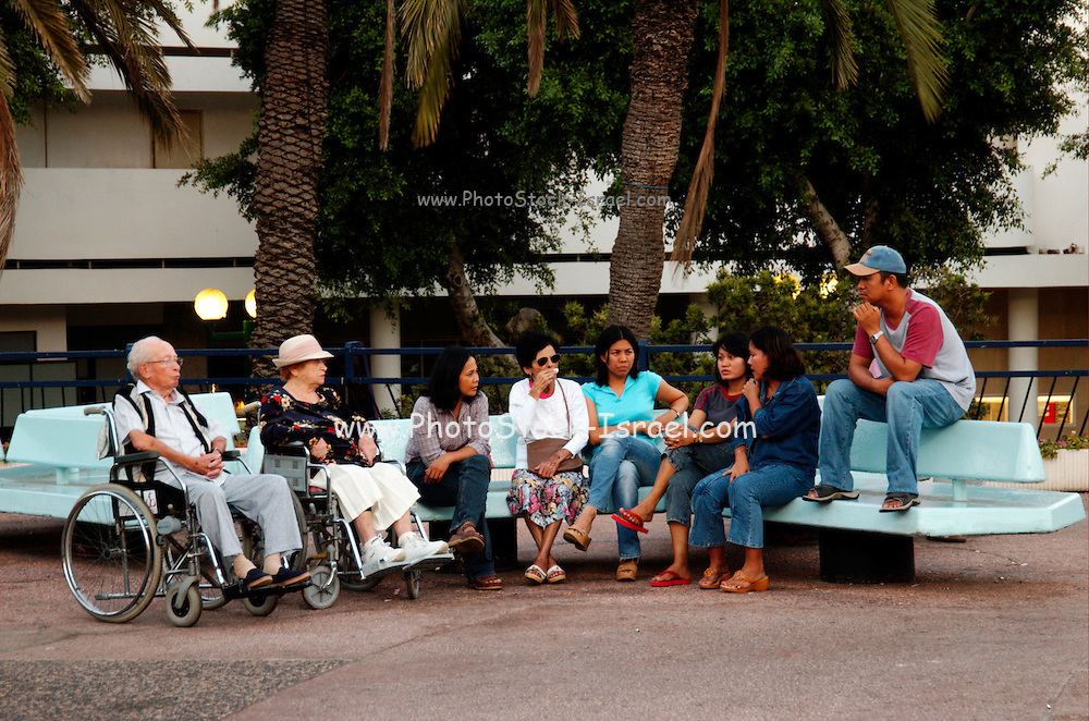 Israel, Tel Aviv Elderly handicapped people and their Philippino servants meet at Dizengoff circle in centre Tel Aviv